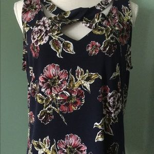 Woman's large floral sleeveless top